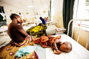 Mother in Bagamoyo with sick child in Malaria hospital