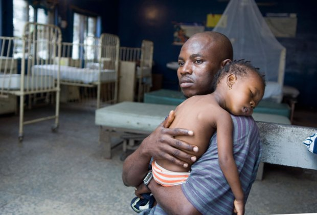 Father in Nigeria with child dying of Malaria