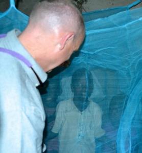 Chris Grandpre hangs nets in Chebunyo